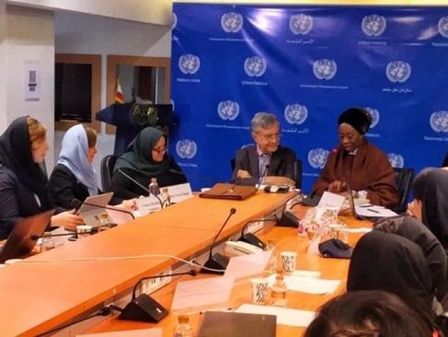 MUN participants listening to UN Resident Coordinator Ms. Daniels (far right)